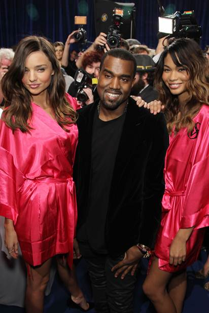 "Description: Kanye West mingles backstage before the show, hanging around with Miranda Kerr and Chanel Iman. West's performance of ""Stronger"" had the audience dancing wildly, as did a surprise appearance from Jay-Z."