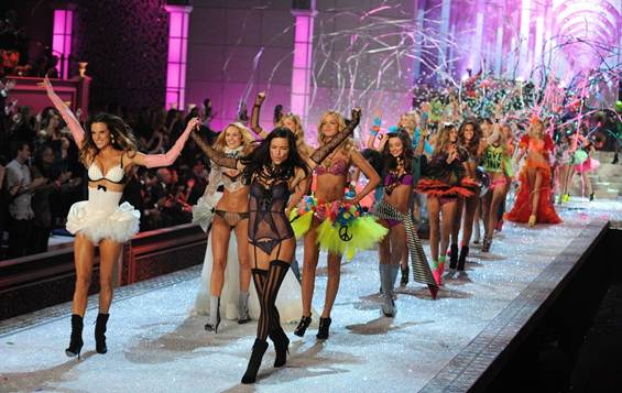 Description: Streamers, Confetti and heart-shaped Mylar balloons fill the air at the show's finale, as Alessandra Ambrosio and Adriana Lima join hands and lead a parade of dancing models down the catwalk.