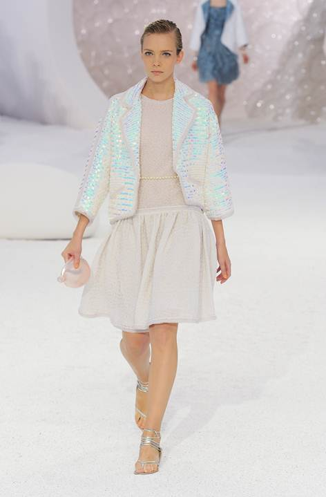 Description: Description: Chanel: A departure from its renowned classic style, the new looks were light, fresh and mother-of-peark luminescent. High-tech fabrics created elegant forms and eye-catching textures, while the show's backdrop – a fantastic underwater world – provided a spectacular setting.
