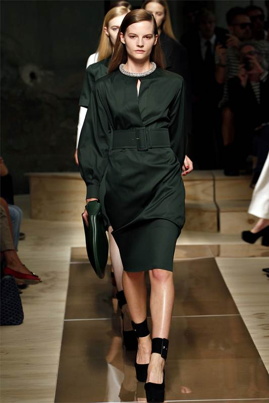 Description: Céline: Sculptural pieces with a nod to couture shapes of the '50s and '60s shone in a collection that was supremely sleek and modern, from the rounded shoulders to the peplum-trimmed tops.