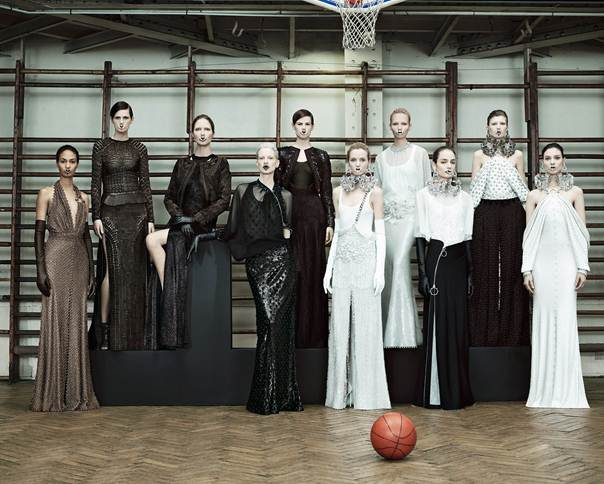 Description: Givenchy: With a focus on sexy tailoring that was both sharp and soft at the same time, the house showed super-slim pants, refined, sharp-shouldered jackers trimmed with swirling peplums, and neat little curved-hem skirts.