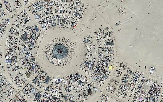 Description: Festival goers at Nevada's Burning Man are asked to become part of the entertainment.