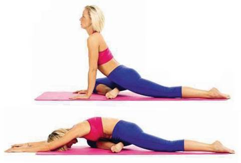 • Carefully draw yourself upright and step back into downward dog. Repeat on your left side.