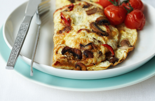 Tomato and mushroom omelet made with 2 eggs and served with 1 slice of wholegrain toast.