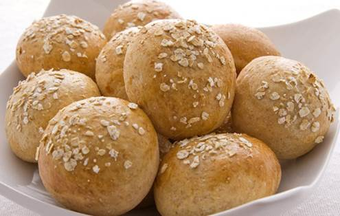 Half a carton of fresh lentil soup, served with a wholemeal roll.