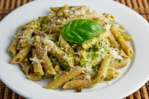 Pesto penne made with 100g wholewheat penne and tossed with 2 tablespoons of fresh pesto sauce.