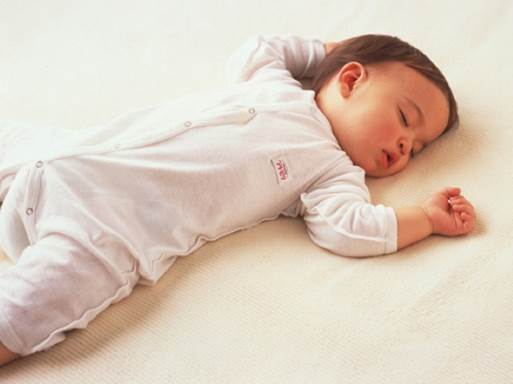 You shouldn't let children sleep alone on adult's bed, except for the case that bed is absolutely safe to children.