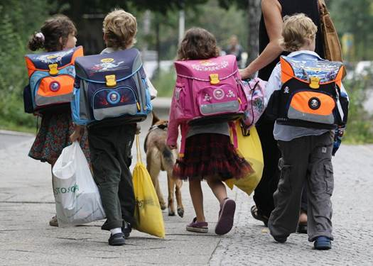 German children have to carrying their stuff on their own.