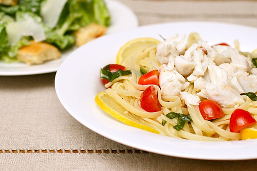 Toss the seafood and marinade into the pasta, season to taste and serve on four plates.