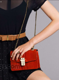 Description: 4. Dress, $264, by Lonely Hearts; belt, $99, by Veronika Maine; ring, $325, by Louis Vuitton; bag, $395, by Angel Jackson at Honey Honey.