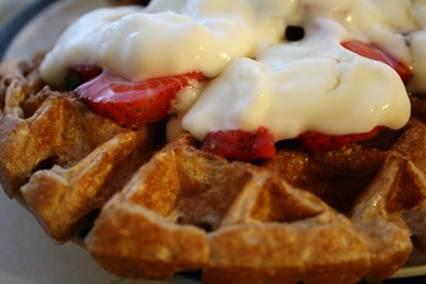 Description: fresh strawberries, yogurt, and a drizzle of sugar-free syrup