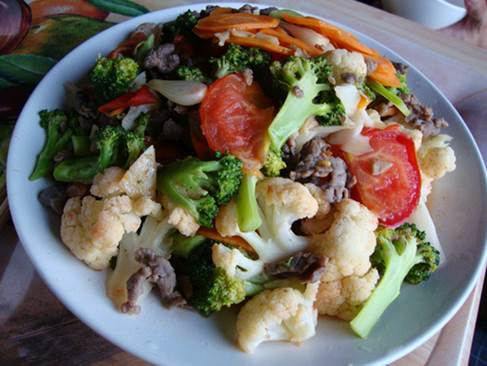 Cauliflower that is fried with beef is rich of nutrients.