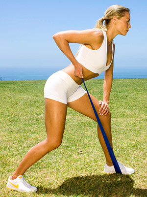 Description: With feet hip-width apart, loop the band under your left foot and grasp either end in each hand.
