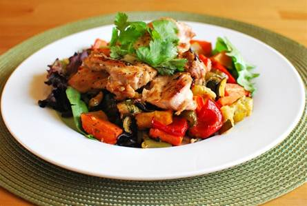 Description: two ounces of chicken with roasted vegetables.