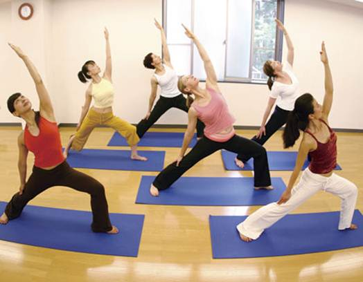 Description: Forty-five yoga students and teachers offered a weekend of classes