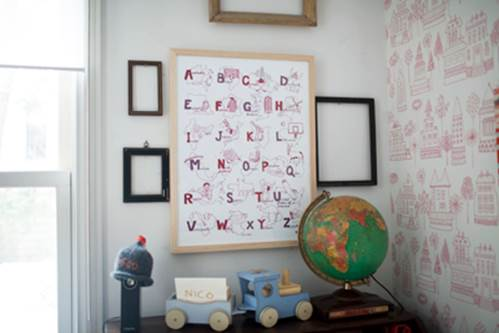 You should hang a red, clear and big alphabet in the wall near baby's bed.