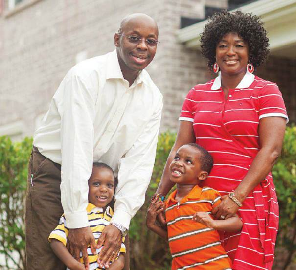 Paying down balances on his high-rate cards is a challenge for Robert Muthumbi of Flowery Branch, Ga., shown with his wife, Rene, and their sons, Gordon and Gerard.