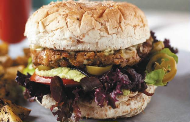 Mexican twist burger with Cheddar, jalapenos, caramelised onions and guacamole
