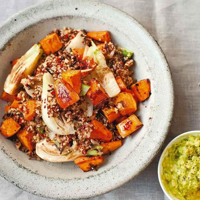 Pilaf of mixed grains, sweet potato and fennel with avocado cream