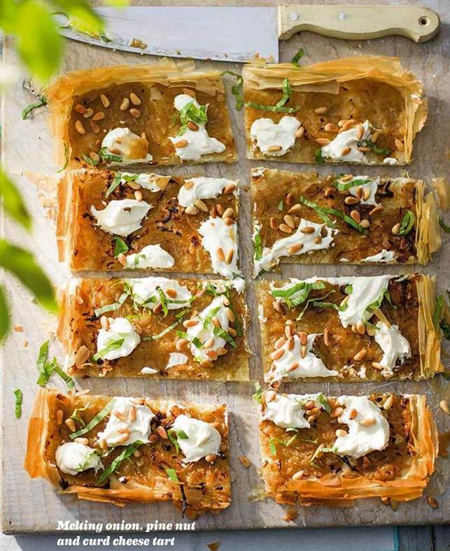 Melting onion, pine nut and curd cheese tart