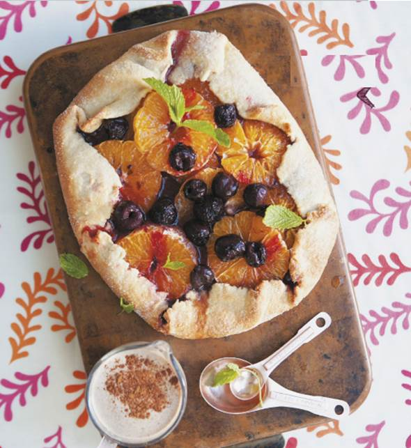 Mandarin and cherry tart with cinnamon and vanilla custard