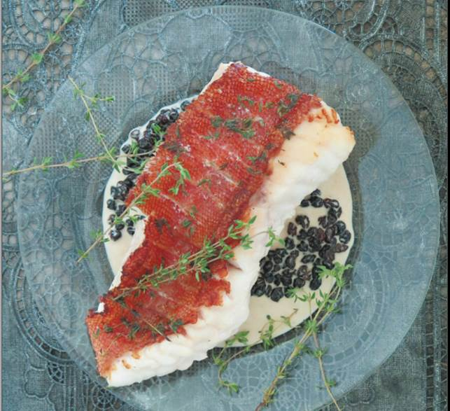 White fish with rum and currant cream