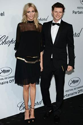 Description: Youthful long-legged Anja Rubik in Gucci's black dress with transparent shoulder