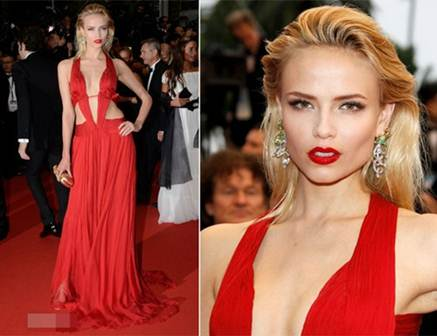 Description: Sexy Natasha Poly in Roberto Cavalli's bold cut dress