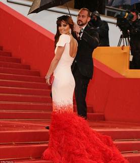 Description: Cheryl Cole attracting the entire look in a mermaid dress combined white and red