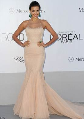 Description: Sexy and elegant Irina Shayk in a simple, soft nude mermaid dress