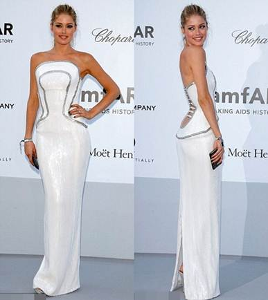 Description: Sexy Doutzen Kroes, Victoria's Secret's angel, in white dress with the bold cutting at the back