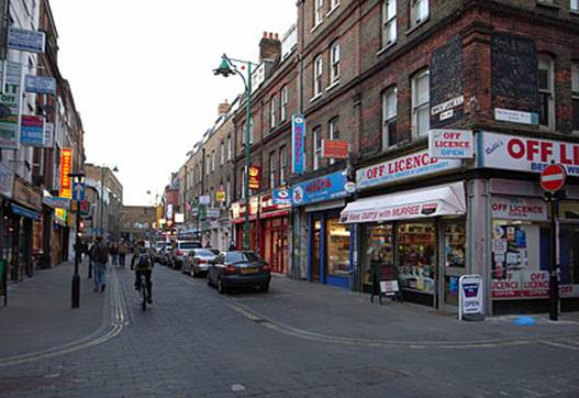 Description: Brick Lane, junction with Princelet Street, E1