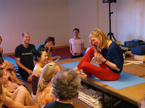 Description: yogis skillfully practicing Anatasana (Reclining Pose Dedicated to Vishnu)