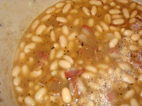 Description: Empty the cannellini beans, including the liquid, into a separate pan, add the stock cube and heat until dissolved