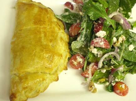 Description: Havle each calzone and serve with a salad.