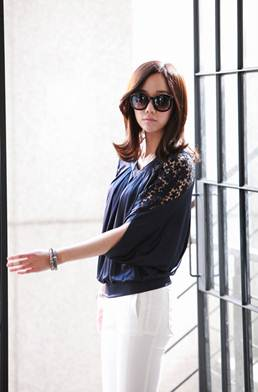 Description: Dark-colored strange lace shirt will create dynamic style.