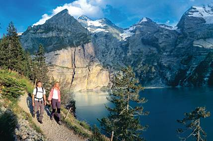 Description: Hiking along Lake Oeschinen, 1,578m above Kandersteg in the Bernese Oberland
