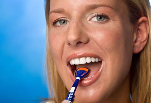 To clean tongue, you can use tongue cleaning tools to erase the coat sticking on the tongue.