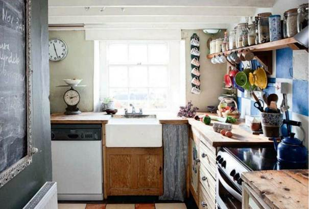 Description: Kitchen - The wonderfully bright room is made up of recycled materials: Carola rescued the floor tiles from a skip; the unite doors were made from an old barn door and the work surface are old scaffold boards