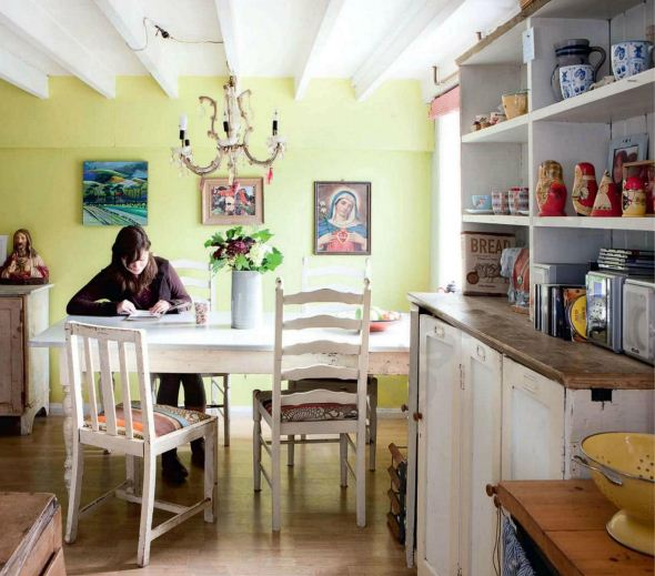Description: Dining room - A yellow wall lifts the room, giving a modern feel to the traditional cottage furniture