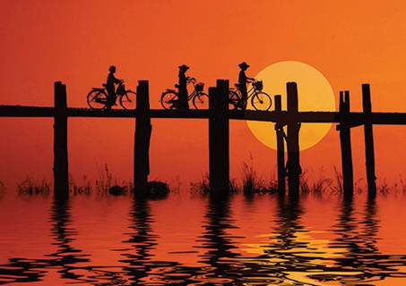 Description: the top to coincide with sunset over the city and the great Irrawaddy River