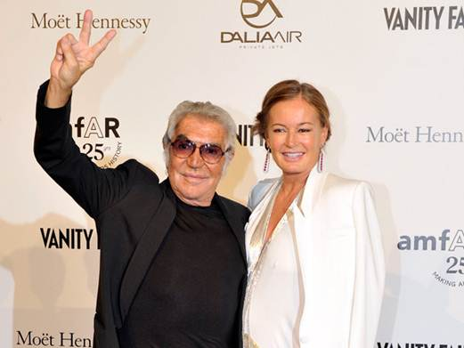 Description: Fashion designer Roberto Cavalli and his wife Eva