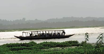 Description: a passenger ferry crossing the Rudrasagar lake to Neermahal