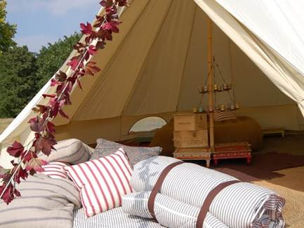 Description: Each tent is romantically decorated with a woven carpet, small mirror and candle