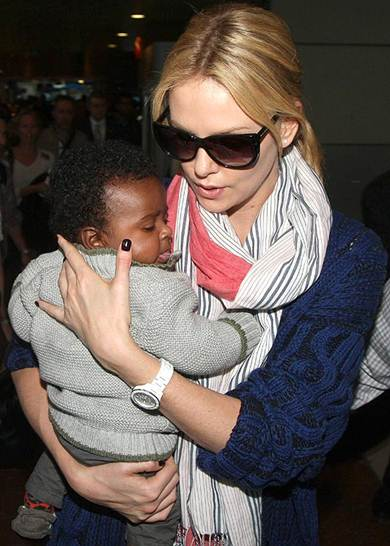 Description: Charlize Theron with her baby son Jackson