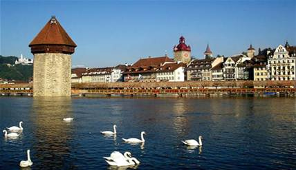 "Description: Lucerne - This is a view of the ""Old City"" from the bridge."
