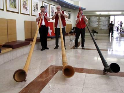 Description: A traditional Swiss horn player