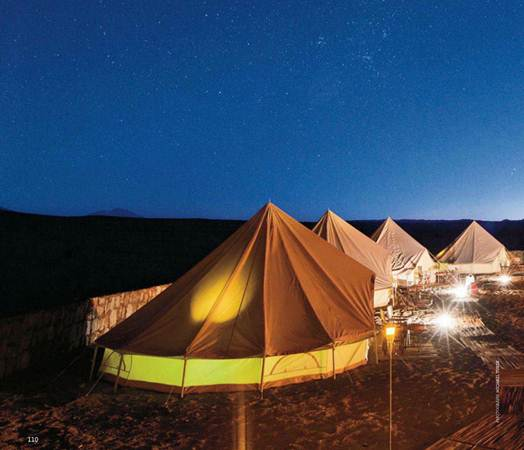 Description: The heated canvas tents of Adventur-Camp in the Atacama Desert