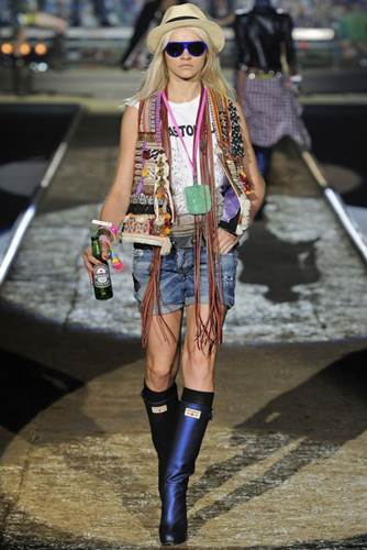 """Description: the """"Rock Summer Festival 2012""""-thcmed show includes an assortment of custom-made rain bow-coloured high-heeled rubber wellies—but there aren't enough for all the models."""