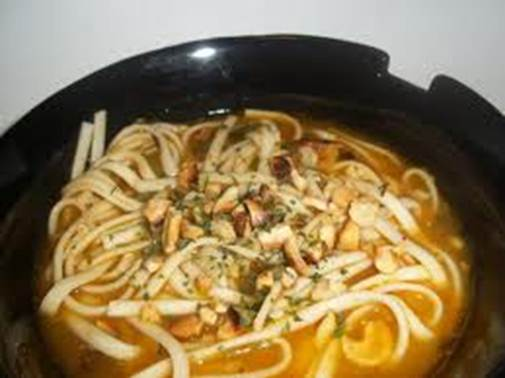 Description: Drunken Noodles in Cashew-Shiitake Broth